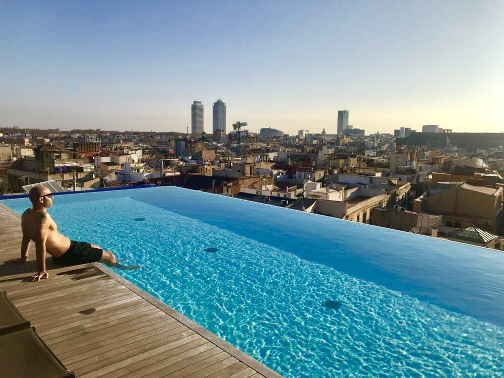 The best rooftop pool in europe at grand hotel central in barcelona therooftopguide com - Infinity pool europe ...