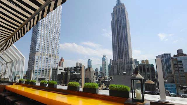 top of the strand rooftop bar in new york nyc the rooftop guide. Black Bedroom Furniture Sets. Home Design Ideas